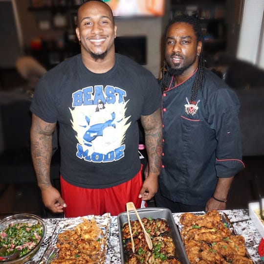 Chef Ace Champion, right, cooked the food for former Green Bay Packers defensive tackle Mike Daniels' 30th birthday at his home earlier this year.