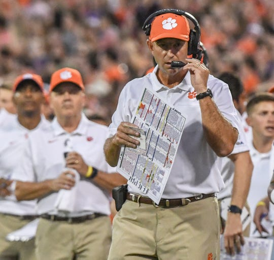 Clemson Head Coach Dabo Swinney communicates on the sideline playing Georgia Tech during the first quarter at Memorial Stadium in Clemson Thursday, August 29, 2019.