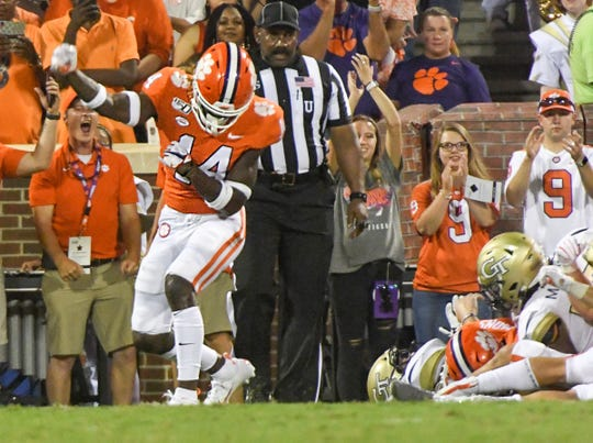 Clemson safety Denzel Johnson (14) celebrates stopping Georgia Tech punter Pressley Harvin III (27) before the goal line on a third-and-one yard play during the second quarter at Memorial Stadium in Clemson Thursday, August 29, 2019.