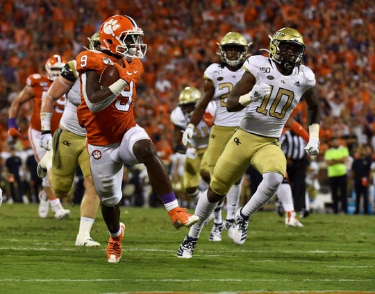 Clemson running back Travis Etienne (9) rushes for a touchdown during the second quarter against Georgia Tech on Thursday, August 29, 2019.