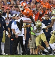 Clemson wide receiver Joseph Ngata (10) leaps over Georgia Tech tight end Nathan Tyler (47) on the opening kickoff during the first quarter at Memorial Stadium in Clemson Thursday, August 29, 2019.