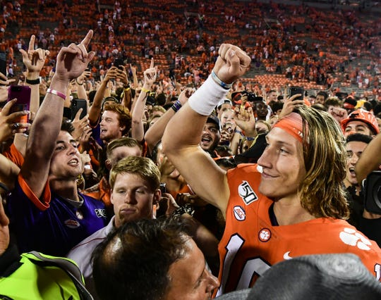 Clemson quarterback Trevor Lawrence (16) celebrates with fans after the game at Memorial Stadium in Clemson Thursday, August 29, 2019.