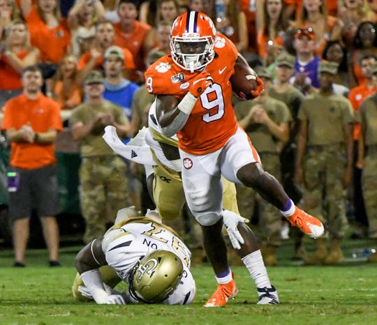Clemson running back Travis Etienne (9) runs 90-yards for a touchdown against Georgia Tech during the first quarter at Memorial Stadium in Clemson Thursday, August 29, 2019. Etienne ran for 205 yards.