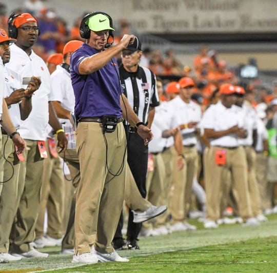 Clemson Defensive Coordinator Brent Venables communicates in the game playing Georgia Tech during the first quarter at Memorial Stadium in Clemson Thursday, August 29, 2019.