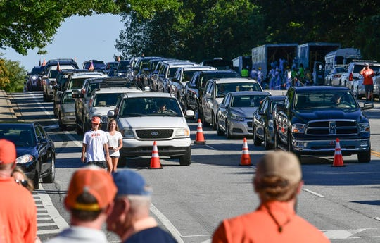 Clemson fans in cars wait for team buses to pass them for Tiger Walk, two hours before kickoff with Georgia Tech outside Memorial Stadium in Clemson Thursday.