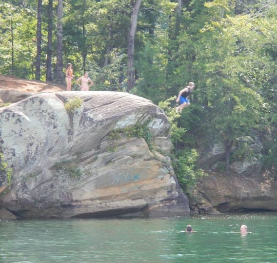 "Children jump off ""the rock"" near Fall Creek Landing on Lake Keowee."