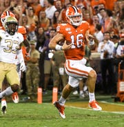 Clemson quarterback Trevor Lawrence rushed for 24 yards and a touchdowns on three carries against Georgia Tech.