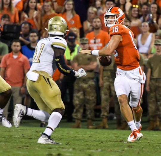 Clemson quarterback Trevor Lawrence (16) throws near Georgia Tech defensive back Zamari Walton (21) during the first quarter at Memorial Stadium in Clemson Thursday, August 29, 2019.