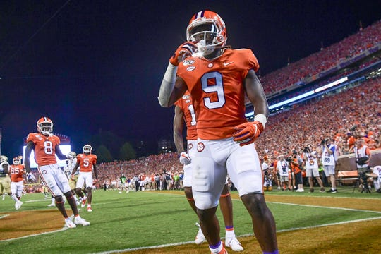 Clemson running back Travis Etienne (9) stops in the end zone after running 90-yards for a touchdown during the first quarter at Memorial Stadium in Clemson Thursday, August 29, 2019.
