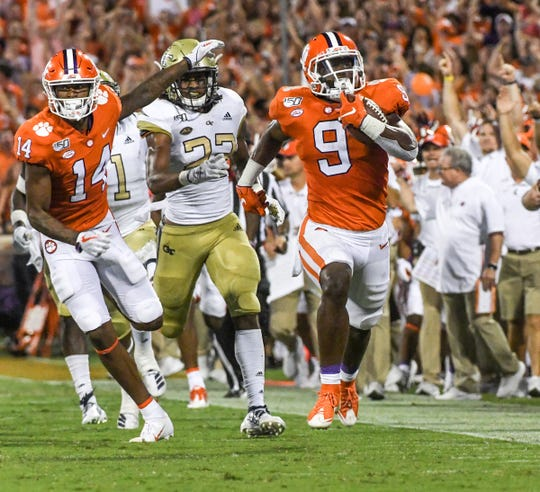 Clemson running back Travis Etienne (9) runs 90 yards for a touchdown during the first quarter at Memorial Stadium in Clemson Thursday, August 29, 2019.