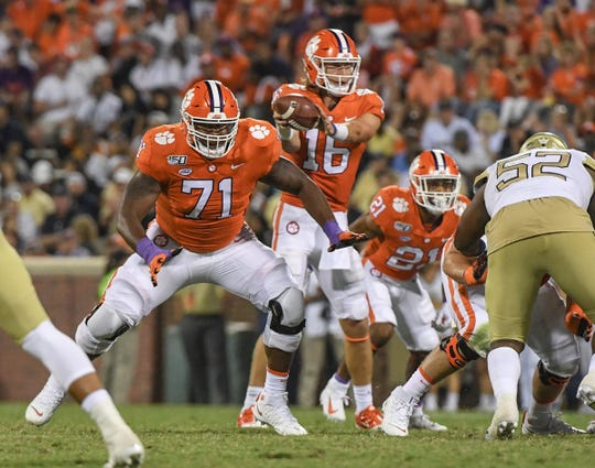 Clemson quarterback Trevor Lawrence (16) takes a snap near offensive lineman Jordan McFadden (71) during the third quarter at Memorial Stadium in Clemson Thursday, August 29, 2019.