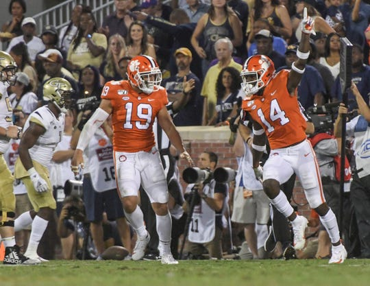 Clemson safety Denzel Johnson (14) celebrates intercepting a ball thrown by Georgia Tech quarterback Tobias Oliver (8) pass on a fourth-and-one yard to go play at the goal line during the second quarter at Memorial Stadium in Clemson Thursday, August 29, 2019.