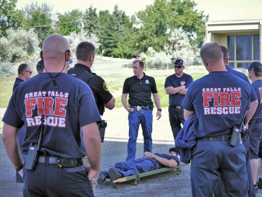 Derek Mahlum of the Great Falls Police Department instructs members of Great Falls Fire Rescue during Rescue Task Force training Friday, Aug. 30, 2019.