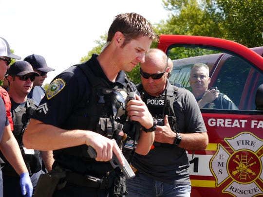 Great Falls Police Department officer Tad Kimmett prepares to escort his Rescue Task Force team into the Salvation Army building in Great Falls during a training exercise Friday, Aug. 30, 2019.