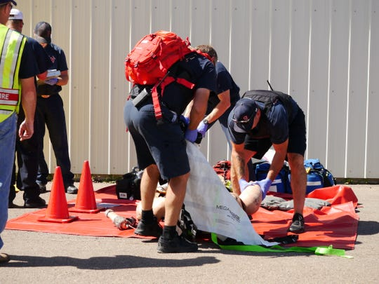 Members of Great Falls Fire Rescue manage a triage area outside the Salvation Army building in Great Falls during Rescue Task Force training Friday, Aug. 30, 2019.
