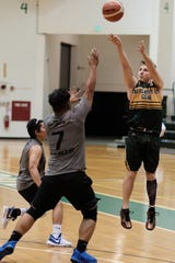 The Tritons' Logan Hopkins shoots against GCC at the UOG Calvo Field House in this file photo.