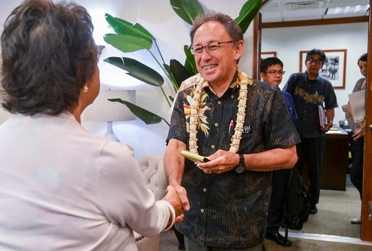 "Okinawa Prefecture Gov. Yasuhiro ""Denny"" Tamaki is greeted by Gov. Lou Leon Guerrero upon their first meeting during a courtesy visit to Adelup on Friday, Aug. 30, 2019."