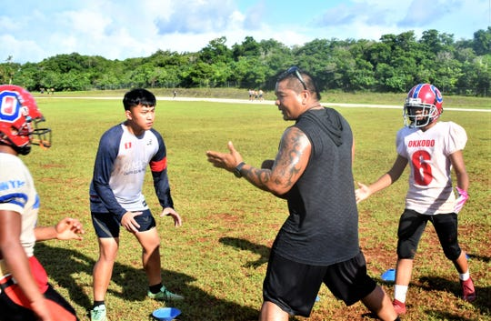 Okkodo High School football coach Drew Apatang does awareness drills with his team on Wednesday, April 29 at Okkodo.