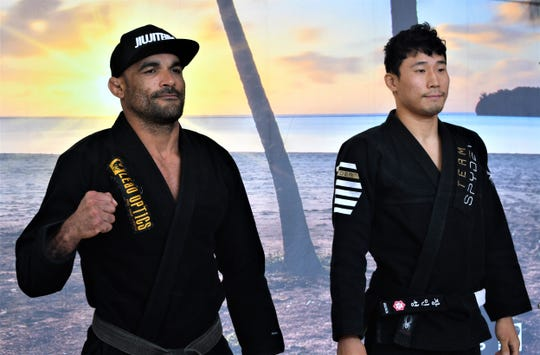 Jose Souza, left and Inseon Jang in their post-weigh-in standoff at the Pacific Star Hotel, in preparation for the 2019 Marianas Open.