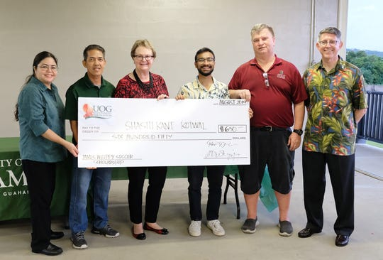 Shashikant Kotwal, third from right, was named a James Whippy Soccer Scholarship winners for 2019 Aug. 28 at a reception at the Guam Football Association's National Training Center.
