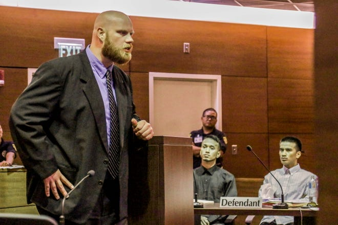 Assistant Attorney General Sean Brown presents his closing arguments as brothers Jordan Rachulap, seated left, and Emmanuel Reselap, listen to his comment during their trial on Friday, Aug. 30, 2019. Both men face felony charges, related to the June 4 incident in Mangilao, which left a man injured after his stomach was slashed with a machete and vehicles of passing motorists were damaged by rocks.