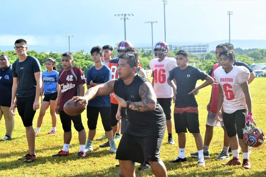 Okkodo High School football coach Drew Apatang does drills with his team on Aug. 28 at Okkodo. The team will forfeit the remainder of the 2019 season.