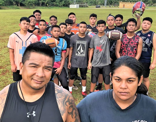 Okkodo High School football coaches Drew Apatang, left and Rita Kaawe=Flores said they are committed to teaching football to any player who wants to learn - even if Okkodo is unable to field a team for 2019.