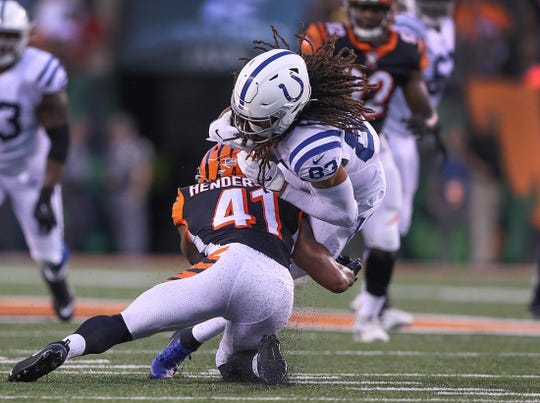 Indianapolis Colts wide receiver Krishawn Hogan (83) is hit by Cincinnati Bengals defensive back Trayvon Henderson (41) in the second quarter of their preseason football game at Paul Brown Stadium in Cincinnati, OH., on Thursday, Aug 29, 2019.