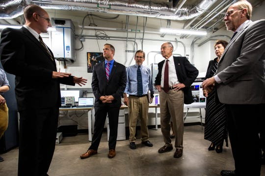 David M. Miles, an assistant professor of physics and astronomy, speaks to NASA Administrator Jim Bridenstine, U.S. Sen. Chuck Grassley, R-Iowa, and U.S. Rep. Dave Loebsack, D-Iowa, while they tour technologies at Van Allen Hall, Friday, Aug. 30, 2019, on the University of Iowa campus in Iowa City, Iowa.