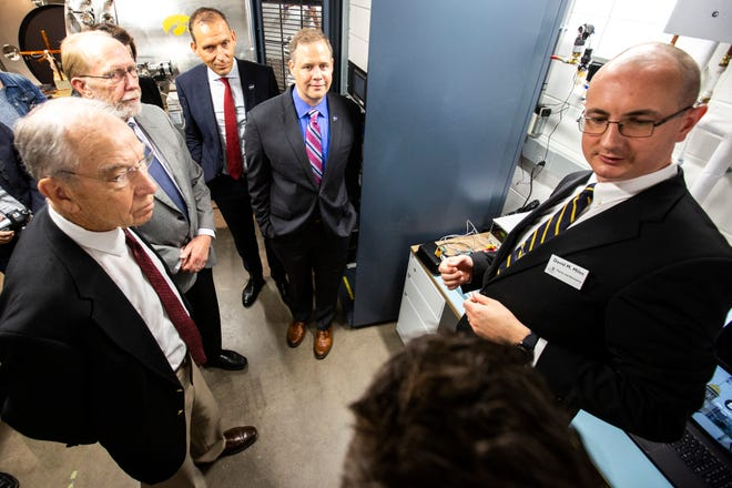 U.S. Sen. Chuck Grassley, R-Iowa, U.S. Rep. Dave Loebsack, D-Iowa, Thomas Zurbuchen, NASA associate administrator for science mission directorate, NASA Administrator Jim Bridenstine, and David M. Miles, an assistant professor of physics and astronomy, tour technologies at Van Allen Hall, Friday, Aug. 30, 2019, on the University of Iowa campus in Iowa City, Iowa. Research projects funded by federal grants  are one of the ways public universities have an economic impact on the state.