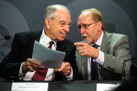 U.S. Sen. Chuck Grassley, R-Iowa, and U.S. Rep. Dave Loebsack, D-Iowa, talk after a press conference at Van Allen Hall, Friday, Aug. 30, 2019, on the University of Iowa campus in Iowa City, Iowa.