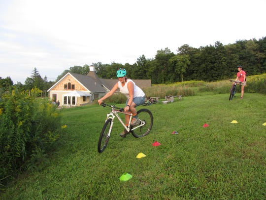 Bikers practice their skills before going on the mountain biking trails.
