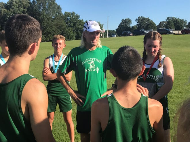 Steve Troxel talks to the members of the cross country team he coaches at Augustine School after they competed at a meet at University School of Jackson on Aug. 29, 2019
