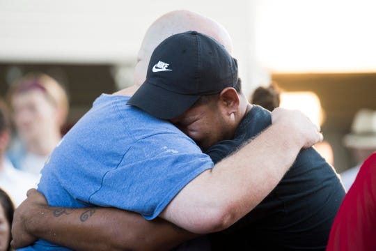 """Philly"" Pheap's best friend Casey Maples hugs Pheap's brother Kompeak Pheap at a vigil for Channara Tom ""Philly"" Pheap at an apartment complex in northwest Knoxville Thursday, Aug. 29, 2019. A Knoxville police officer shot and killed Pheap Monday Aug. 26."