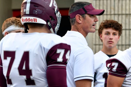 Bearden football coacf Morgan Shinlever with his players before the start of the game at Maryville on Friday, August 30, 2019.