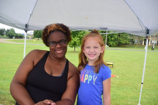 "Registrar Jennifer Billingsley, with Personal Best Racing with one of the youngest volunteers Amelia Longmire, 7, at the inaugural Pathways 5K benefiting East Tenn. Children's Home held at 10 Mile Creek Greenway at West End Church of Christ Sunday, Aug. 25. ""I just want to help out any way I can, even if that's just handing out water,"" said Longmire."