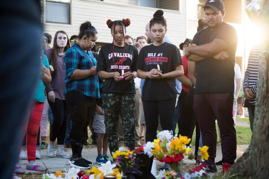 "Attendees stand at a vigil for Channara Tom ""Philly"" Pheap at an apartment complex in northwest Knoxville Thursday, Aug. 29, 2019. A Knoxville police officer shot and killed Pheap Monday Aug. 26."