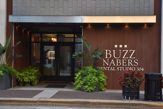 Buzz Nabers Dental Studio, 304 S. Gay Street.