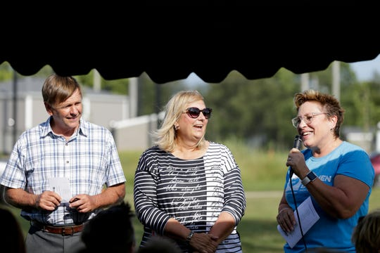 Doug and Cindy Taylor, left and center, react as they are introduced by Jan Nielsen at a Habitat for Humanity of Lafayette house blessing, Thursday, Aug. 29, 2019 in Lafayette.