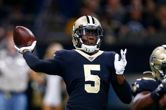 New Orleans Saints quarterback Teddy Bridgewater (5) passes in the first half of an NFL preseason football game against the Miami Dolphins in New Orleans, Thursday, Aug. 29, 2019. (AP Photo/Butch Dill)