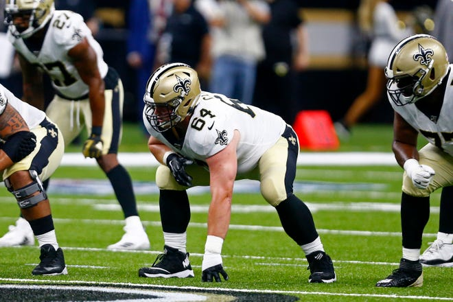 New Orleans Saints Will Clapp (64) lines up on the line of scrimmage in the first half of an NFL preseason football game against the Minnesota Vikings in New Orleans, Friday, Aug. 9, 2019. (AP Photo/Butch Dill)
