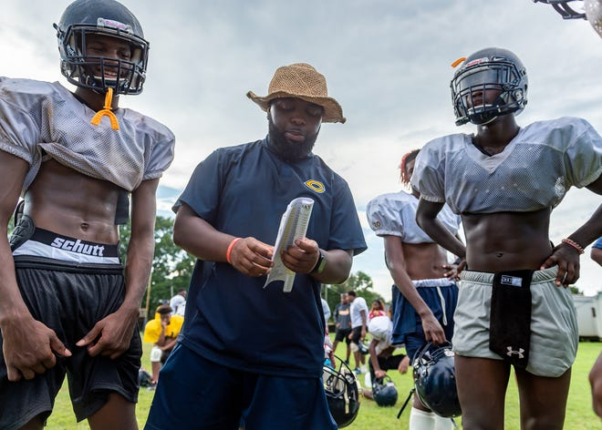 Carencro offensive coordinator Gavin Peters talks to players at practice Aug. 27.