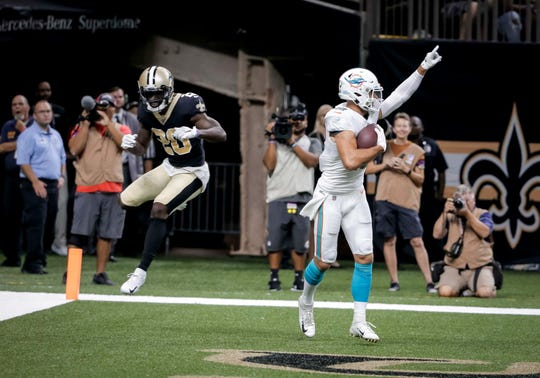 Aug 29, 2019; New Orleans, LA, USA; Miami Dolphins wide receiver Reece Horn (18) celebrates after a touchdown catch past New Orleans Saints cornerback Ken Crawley (20) during a preseason game at the Mercedes-Benz Superdome. Mandatory Credit: Derick E. Hingle-USA TODAY Sports
