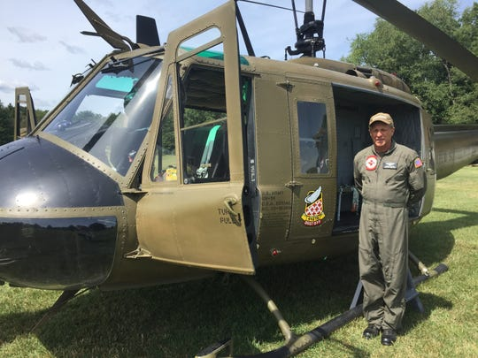 Johnnie Walker talks about a Huey helicopter used in the Vietnam War that his Indiana-based nonprofit American Huey 369 restored to working order, Friday, Aug. 30, 2019.