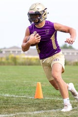 Fowlerville's Hunter Knaggs ran for two touchdowns and forced a fumble with a sack in a 28-7 victory at Charlotte.