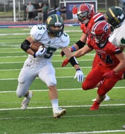 Howell's Jonah Schrock ran for two touchdowns in a 58-21 loss at Livonia Franklin on Thursday, Aug. 29, 2019.