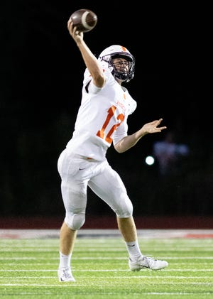 Brighton quarterback Colby Newburg threw for two touchdowns and ran for two others in a victory at Novi.