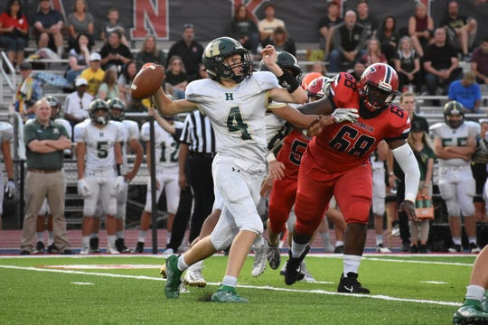 Howell quarterback Zach Metz was 9-for-19 for 109 yards, one touchdown and one interception in a 58-21 loss at Livonia Franklin on Thursday, Aug. 29, 2019.