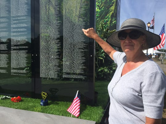 Linda Sroka points out her late brother-in-law Joseph John Strucel's name on a memorial wall honoring soldiers from Michigan who were killed in the Vietnam War, Friday, Aug. 30, 2019.