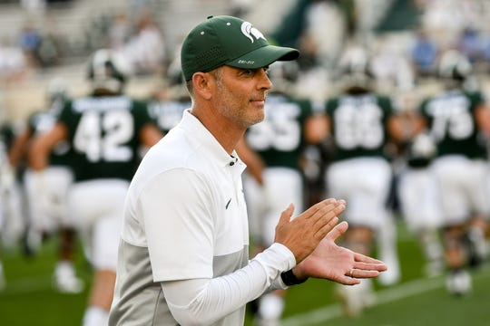 Michigan State offensive coordinator Brad Salem works with the team before the Spartans game against Tulsa on Friday, August 30, 2019, at Spartan Stadium in East Lansing.